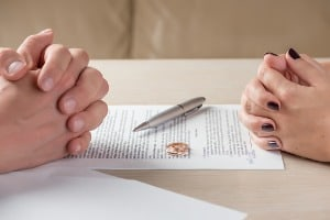 wife and husband signing divorce documents or premarital agreement picture id609945598 The Divorce Process